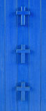 Three in a row. Three blue crosses on the blue background Stock Images