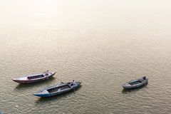 Three Row Boats on the Ganges River at Varanasi, India Royalty Free Stock Images
