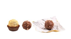 Three in row chocolate bonbons. Stock Images