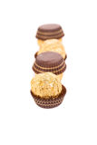 Three in row chocolate bonbons. Royalty Free Stock Image
