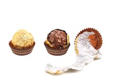 Three in row chocolate bonbons. Stock Photo