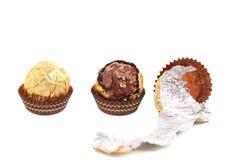 Three in row chocolate bonbons. Stock Photo
