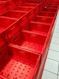 Empty red boxes at market. Three row empty red boxes at market at morning royalty free stock photos