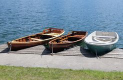 Three rowboats moored on the shore of Lake Stock Photography