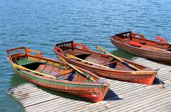 Three rowboats moored on the shore of Lake Royalty Free Stock Image