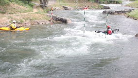 Three rowers swim in a kayak against the river stock footage