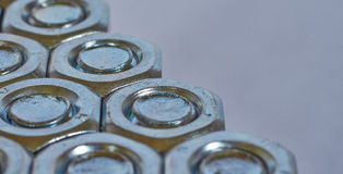 Three rows of bolts and nuts Royalty Free Stock Image