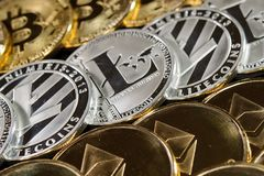 Three rows of cryptocurrency coins . Litecoin, bitcoin, ethereum Stock Photo