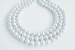 Three rows of natural pearl necklace on white Stock Photo