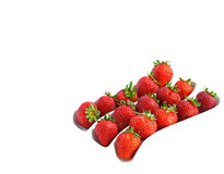 Three rows of strawberries on white. In furrows of white dish Royalty Free Stock Images