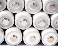 Batteries. Three rows of white rechargeable AA batteries Royalty Free Stock Photo
