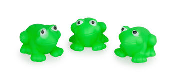Three rubber green toad. Isolated on white background Royalty Free Stock Images