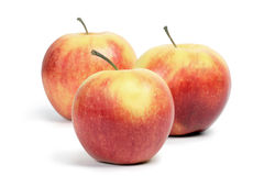 Three ruddy apples. Three ruddy apples on a white background Stock Images