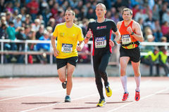 Three runners on the final stretch at Stockholm Stadion. STOCKHOLM - MAY 31: Three runners on the final stretch at Stockholm Stadion in ASICS Stockholm Marathon Royalty Free Stock Image