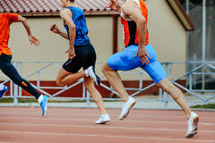 Three runners sprinters men. Run in stadium on competition Stock Images