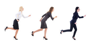 Three running business women in business clothes isolated on whi. Te background Royalty Free Stock Images