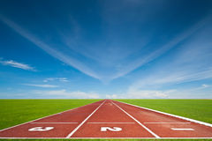 The three running tracks. Running track with three lanes over sky and clouds Stock Photos