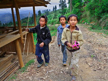 Three rural adolescents aged 12 years and stroll around the neighborhood of the village, Basha Miao Village, Congjiang County, So. GUIZHOU, CHINA - APRIL 10 stock image