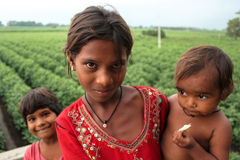 Three rural children expressive faces. Royalty Free Stock Photos