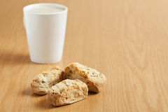 Three rusks with a mug of coffee Royalty Free Stock Photo