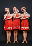 Three russian beauties. Over dark background Royalty Free Stock Images