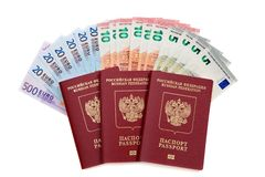 Three russian passports with fan of euro banknotes Royalty Free Stock Photo