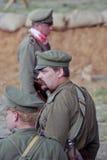 Three Russian soldiers-reenactors. Royalty Free Stock Photos