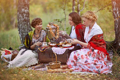 Three russian women. In the national suits Royalty Free Stock Images