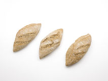 Three rustic baguettes isolated on white background Royalty Free Stock Photo