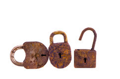 Three rusty lock isolated on white Stock Photos