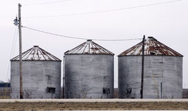 Three Grain Bins Stock Photography