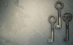 three rusty old metal keys Royalty Free Stock Photo