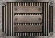 Three rusty plates over metal grid background Stock Photo