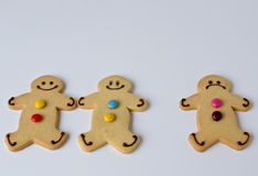 Three's a crowd. Three shortbread figures demonstrate that three is often a crowd stock photos