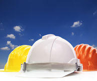 Three of safety helmet construction protection on white against Stock Images