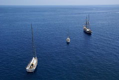 three sail boats in blue sea Royalty Free Stock Photography