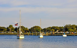 Three sailboats near a dock Royalty Free Stock Images