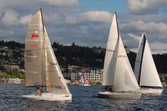 Three sailboats race on Lake Union Stock Images