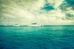 Three sailboats in the sea Stock Photography