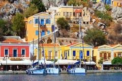 Three sailing yachts at Marina of Symi on a Sunny summer day Greece Royalty Free Stock Image