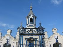 The Three-Sainted Church in Pryluky. On the background of blue sky stock photos