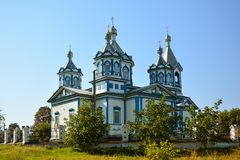 Three Saints Church in Pryluky, Chernihivska oblast, Ukraine. B. Eautiful wooden white building with domes for religious purposes XIX century, Orthodox Church stock image