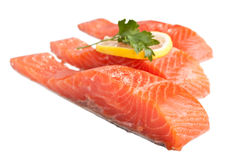 Three Salmon Pieces Isolated. Three Fresh Pink Salmon Pieces with Lemon Slice and Fresh Parsley Isolated Royalty Free Stock Images