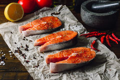 Three Salmon Steaks Prepared for Cooking Stock Images