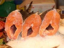 Three salmons. At La Boqueria market in Barcelona, Spain Royalty Free Stock Photography