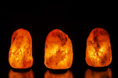 Three salt lamps on black background. Hymalayan salt lamps on black background Stock Images