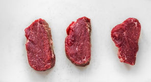 Three salted raw beef filet Stock Photography