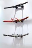 Three samurai swords hang on white wall. In Japanese restaurant Stock Photos