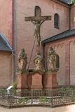 Three sandstone sculptures in front of the church of st. marcellinus and peter, seligenstadt, hesse, germany.  stock image