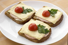 Three sandwich with grey bread,ham and cheese Royalty Free Stock Photos